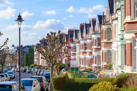 Row of typical English terraced houses in West Hampstead, London Фото со стока