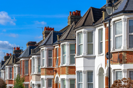 Row of typical English terraced houses in West Hampstead, London 스톡 콘텐츠