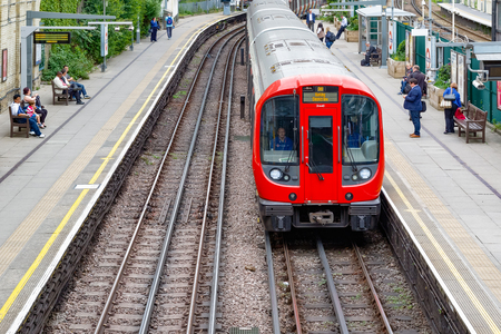 London, UK - May 23, 2017 - West Brompton underground station platforms, with northbound train arriving