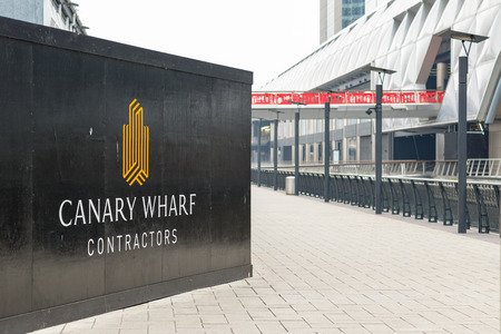 London, UK - May 24, 2017 - New development construction site in Canary Wharf with Crossrail station in the background