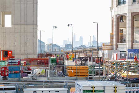 London, UK - May 24, 2017 - Building site of Park Place, a new office development in Canary Wharf, with London cityscape in the background Redakční