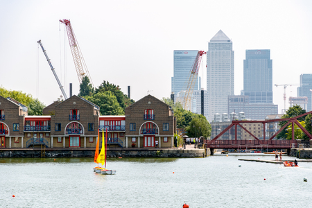 London, UK - June 21, 2017 - Skyscrapers in Canary Wharf seen from Shadwell Basin