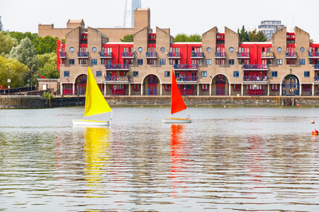 Dockside apartments at Shadwell Basin providing space for summer activities in London