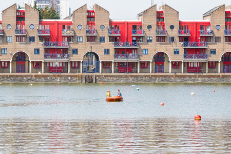 London, UK - June 21, 2017 - Shadwell Basin provides space for water sports and adventurous activities with dockside apartments in the background
