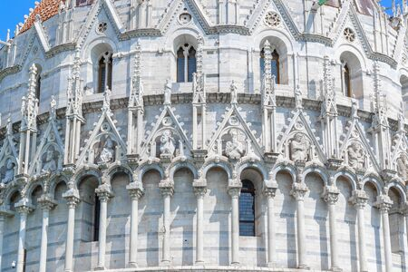 Facade of the Pisa Baptistery at Piazza dei Miracoli (Square of Miracles) in Italy