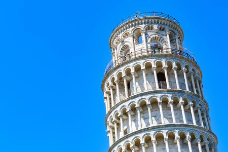 Leaning tower of Pisa, Italy against a cloudless blue sky