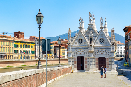 Pisa, Italy - June 26, 2019 - Santa Maria della Spina, a small church in the Italian city of Pisa, is located on the bank of river Arno