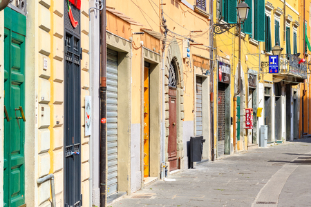 Pisa, Italy - June 26, 2019 - Typical street view of old town in Pisa, Tuscany, Italy