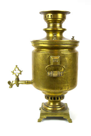 Antique copper samovar with yellow wooden handles, isolated on a white background. Old things, kitchen utensils. Reklamní fotografie