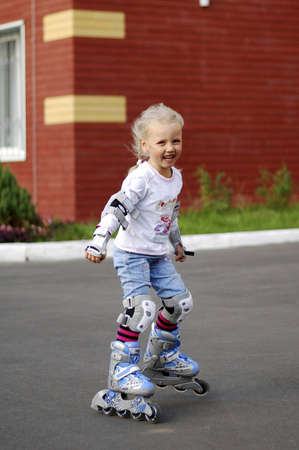 Girl roller-skating in the street in the summer Stock Photo - 15177686