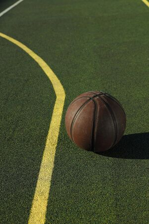 basketball ball on the court with green floor