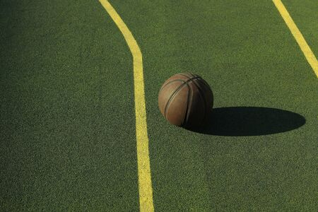 basketball ball on the court with green floor Stock Photo