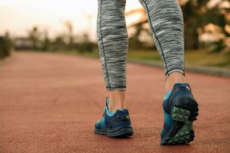 beautiful female legs on a morning run