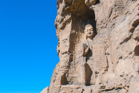 stone Buddha sculpture in the cave photo