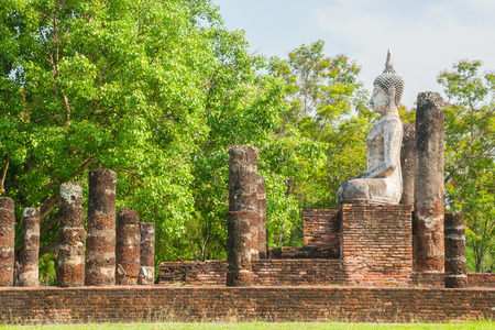 Buddha sculpture and temple ruins in Sukhothai historical park, Thailand photo