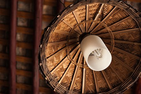 lamp with bamboo lampshade hanging under the roof photo