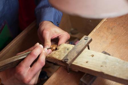 craftsman carving the olive kernel photo