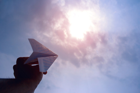 fly a paper airplane Stock Photo