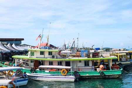 fishman: fish boats on the bay