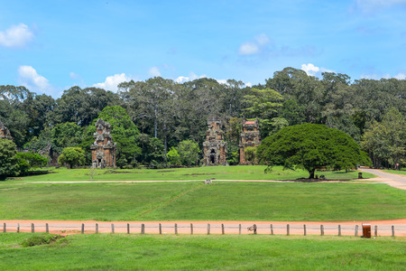 angkor thom: view of Angkor Thom historic park, grass and old towers Stock Photo