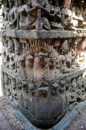 gods: gods figures engraved on stone wall Stock Photo