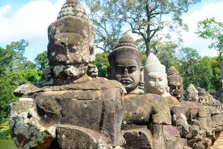 gods: gods sculpture on the bridge fence
