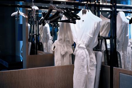 bath robe: bath robe hanging in wardrobe Stock Photo