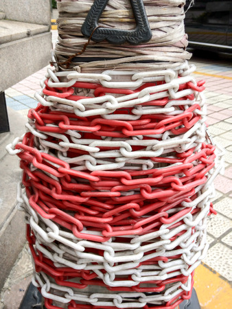 wire mess: tangled chain round the pillar