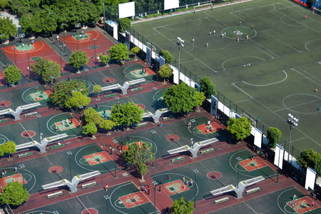 outdoor basketball court: Aerial view of outdoor basketball court and football field