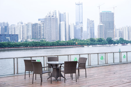 cbd: coffee bar by the river, opposite side is Guangzhou CBD Stock Photo