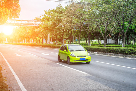 green car driving on the road 免版税图像