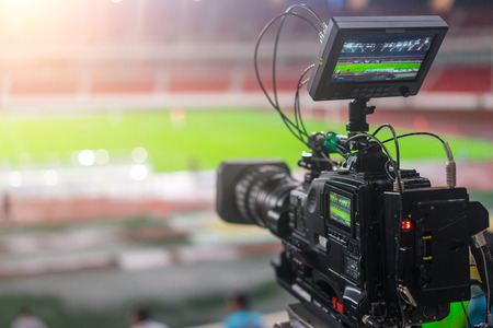 telecast: video camera recording in a football game