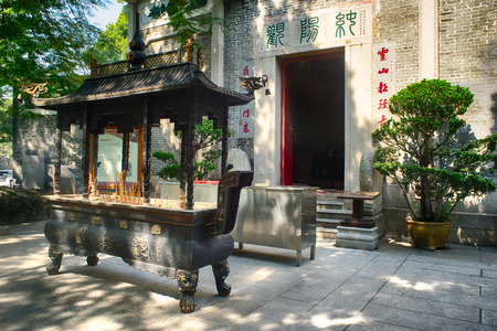 the existing: GUANGZHOU, CHINA - Oct.17: Incense burner in front of the temple. Chunyang Temple is a Taoist architecture built in the Qing Dynasty and the only existing Quanzhen Taoist temple in the city. Editorial