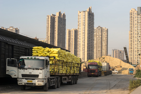 loaded: Guangzhou, China-Oct. 18, 2015: Loaded trucks in the site. Loaded trucks are parking in a construction site of residential buildings.