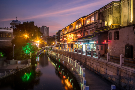relics: GUANGZHOU, CHINA-Oct. 18, 2015: Night view of Litchi Bay. Along the Litchi Bay there are many historical relics and historical architectures, now its a famous tourist attraction in Guangzhou. Editorial