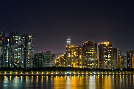 river side: night view of buildings by the river side and reflection Stock Photo