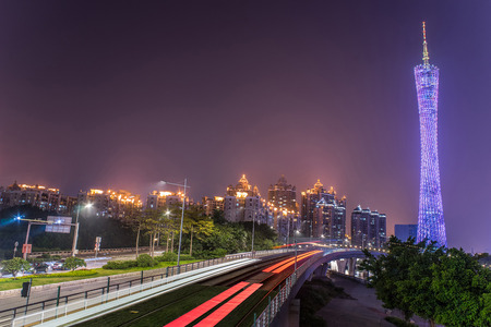 streetcar: Guangzhou, China-Jan.8,2016:Guangzhou Tower and streetcar track. Theres a sightseeing streetcar line along the riverside named the most beautiful 7.7 kilometers of Guangzhou city.