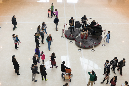 crowds of people: Stanley, Hong Kong-Jan.10,2016:Music bank in the hall. A music bank is performing in the shopping mall for travelers.