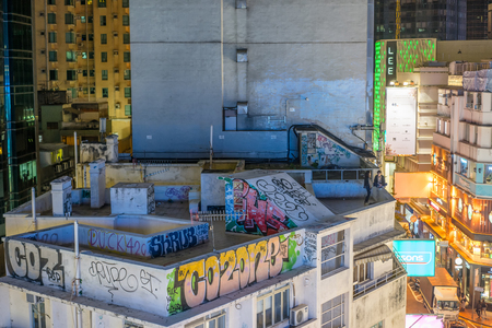 garabatos: Hong Kong, China-Jan.9,2016: Roof top scene of building. Graffiti on the roof top of a building in Causeway Bay. Editorial