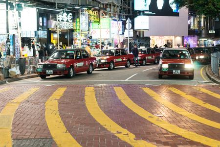 causeway: Causeway Bay, Hong Kong-Jan.9,2016: Taxis are waiting for passengers. Causeway Bay is a popular shopping area in Hong Kong.
