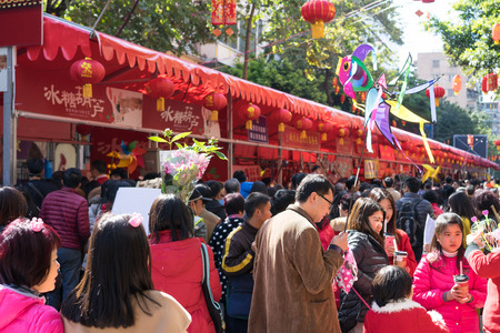 urban scene: Guangzhou, China-February.7, 2016: New Years eve traditional flower fair in Guangzhou.  In Guangzhou citizens will go to flower fair to buy flower and decorations for the Chinese New Year. Editorial