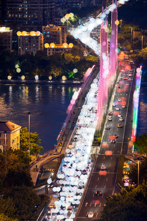 slow lane: City night view. Busy traffic scene of Haiyin Bridge in Guangzhou at night. Stock Photo