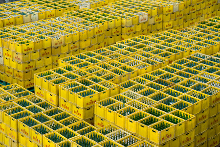 boxes stack: Guangzhou, China-Feb. 27, 2016: Beer boxes stack in the yard. Editorial