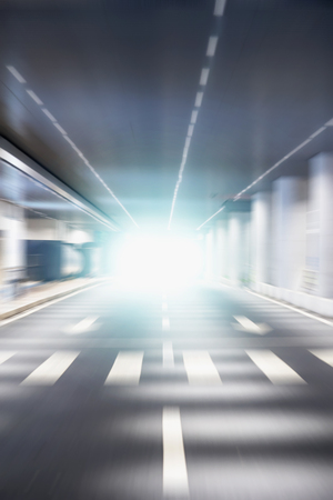 tunnel light: blurred tunnel light background Stock Photo