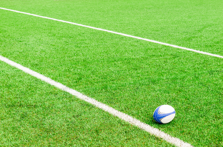 rugby ball on the ground Stock Photo