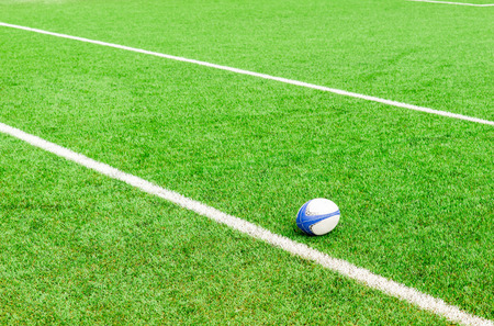 rugby ball on the ground Archivio Fotografico