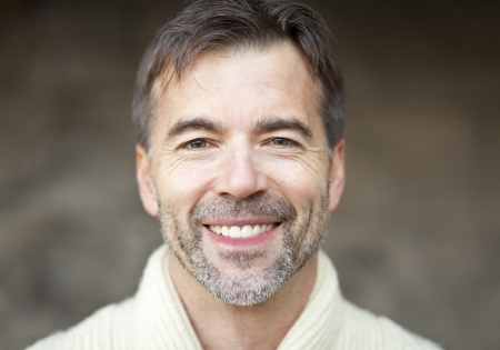 Close-up Of A Successful Adult Man Smiling Stock Photo - 23263343