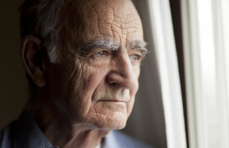 depression: Portrait Of Elderly Man Lost In Thought