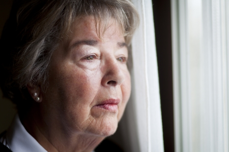 one senior woman only: Senior woman lost in thought