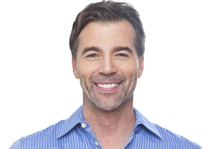 Portrait Of A Mature Man Smiling At The Camera Isolated On White Banco de Imagens